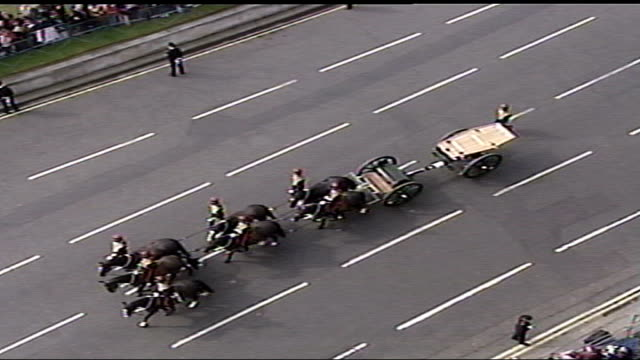 Queen mother's funeral arrivals and pall bearers carrying coffin Empty gun carriage along towards / MS gun carriage / Foreign royal couple arriving...