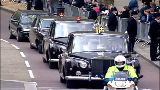 Queen mother's funeral arrivals and pall bearers carrying coffin Male members of Royal family and Princess Anne leave Buckingham Palace by car / Good...