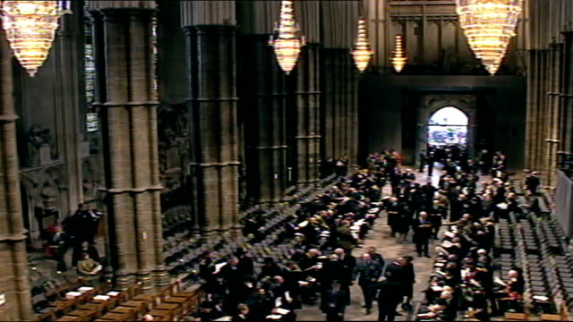queen mother's funeral: arrivals; tsls guests arriving and taking seats in abbey / crowd behind railing as part of canadian flag seen / various... - スタッフォードシャー リッチフィールド点の映像素材/bロール