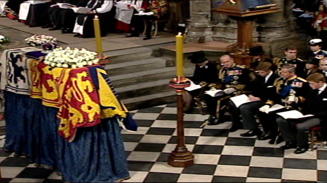 queen mother's funeral: funeral service; choir singing sot / cardinal cormac murphy o'connor speaking sot / coffin as royal mourner behind singing... - cormac murphy o'connor stock videos & royalty-free footage