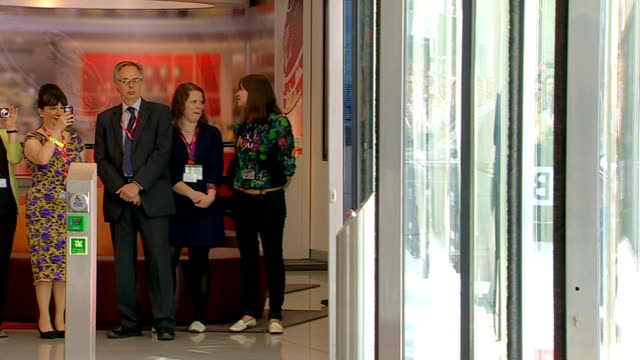 queen officially opens bbc's new broadcasting house people waiting / queen arriving and getting out of car different angle view of queen greeting... - bbc video stock e b–roll
