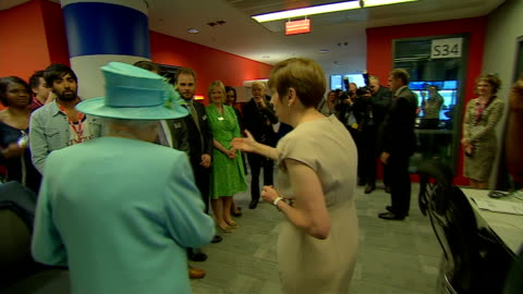 queen officially opens bbc's new broadcasting house; queen along and greeting o'donoghue and other band members / bbc staff in offices with phones... - james naughtie stock-videos und b-roll-filmmaterial