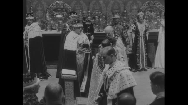 queen on kneeler receives host for communion from archbishop of canterbury archbishop steps over to philip on kneeler and gives him host while... - coronation stock videos and b-roll footage