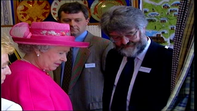 queen on walkabout in berwickupontweed bbc pool northumberland berwickupontweed photography*** gvs queen looking at souvenirs for sale in shop / - for sale englischer satz stock-videos und b-roll-filmmaterial