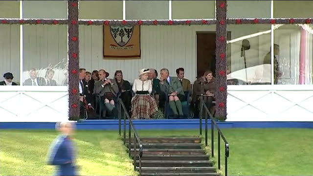 queen opens braemar highland games / scottish referendum children along in sack race royals seated watching games pull out to reporter to camera - sack race stock videos & royalty-free footage