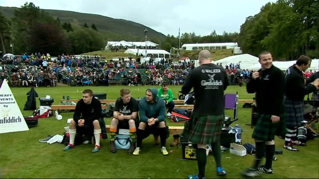 queen opens braemar highland games various iof bagpipe and drum bands marching along / girls taking part in highland dance competition walking along... - highland games stock videos & royalty-free footage