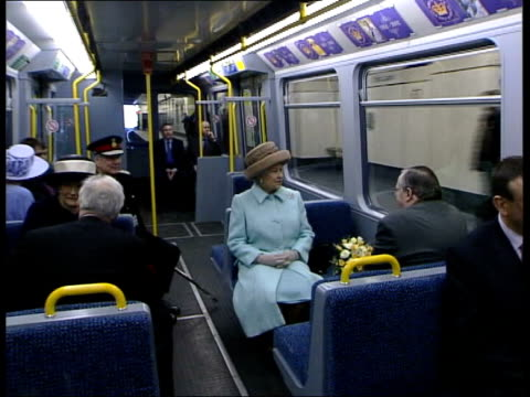 streaker arrested itn england gateshead queen elizabeth ii sitting on new metro train tgv 'winking' millennium bridge as opened by queen pull out - tyne and wear stock videos & royalty-free footage