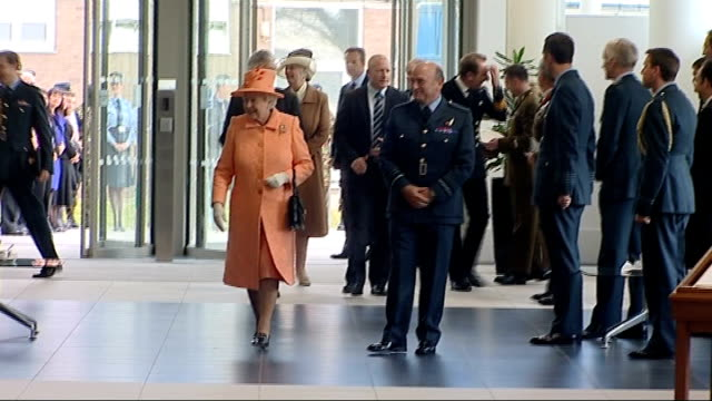 queen opens new military headquarters england london ext car arriving / duke of edinburgh and queen elizabeth out of car shakes hands with raf... - saluting stock videos and b-roll footage