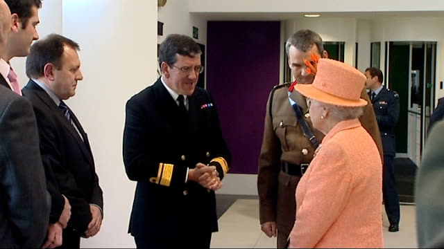 queen opens new military headquarters queen walks through doors then shakes hands with navy officer then civilian staff / queen talking with officers... - the victoria cross stock-videos und b-roll-filmmaterial