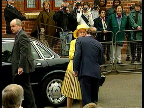 queen praises princes trust itn london ext queen elizabeth ii from car and greeted by prince of wales on visit to housing development built by the... - elizabeth ii stock videos & royalty-free footage