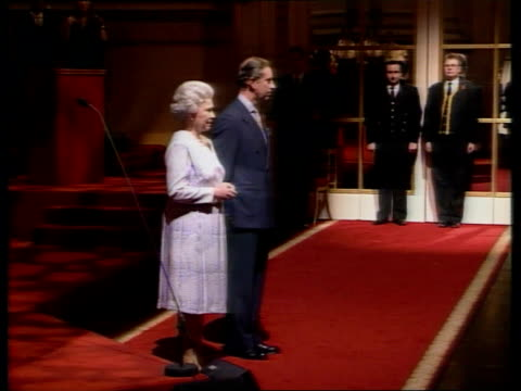 queen praises princes trust pool london buckingham palace queen elizabeth ii and prince charles along into room for reception held to mark awarding... - ben elton stock videos and b-roll footage