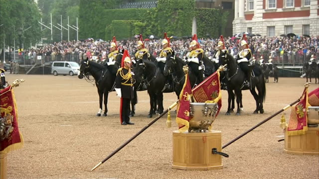 Queen presents new standards to Household Cavalry ENGLAND London Horse Guards Parade Officials and troops waiting / Queen Elizabeth II and Prince...