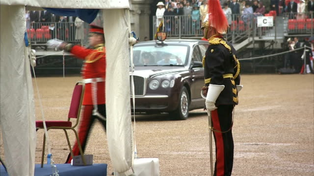 Queen presents new standards to Household Cavalry **Music heard intermittently SOT** Wide shot of ceremony as national anthem heard SOT / mounted...