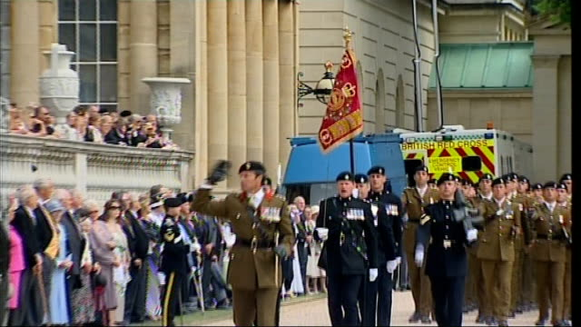 queen presents new standards to royal tank regiment troops marching on parade ground salute god save the queen played sot troops remove hats three... - god stock videos & royalty-free footage