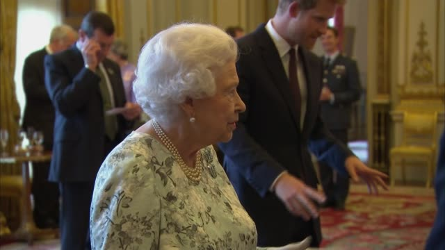 Queen presents Queen's Young Leaders Awards ENGLAND London Buckingham Palace INT Mo Farah and Liam Payne waiting with others / Queen Elizabeth II...