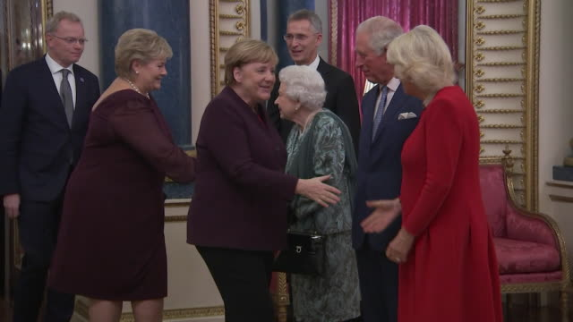 queen prince charles and duchess of cornwall greet german chancellor angela merkel at buckingham palace reception during nato summit - chancellor of germany stock videos & royalty-free footage