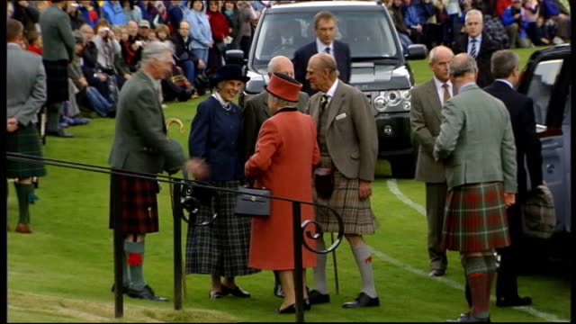 queen princes philip and charles attend braemar highland games scotland aberdeenshire ballater ext the queen prince philip the duke of edinburgh and... - highland games stock videos & royalty-free footage