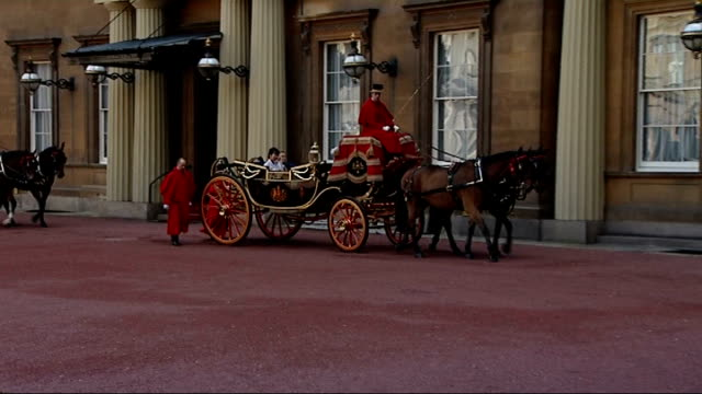 Queen receives new South Korean ambassador ENGLAND London Buckingham Palace EXT Horse drawn carriage carrying new South Korean ambassador Lim Sungnam...