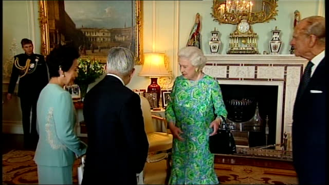 queen reception for praemium imperiale award winners england london buckingham palace int prince hitachi and princess hitachi of japan into room and... - 座る点の映像素材/bロール