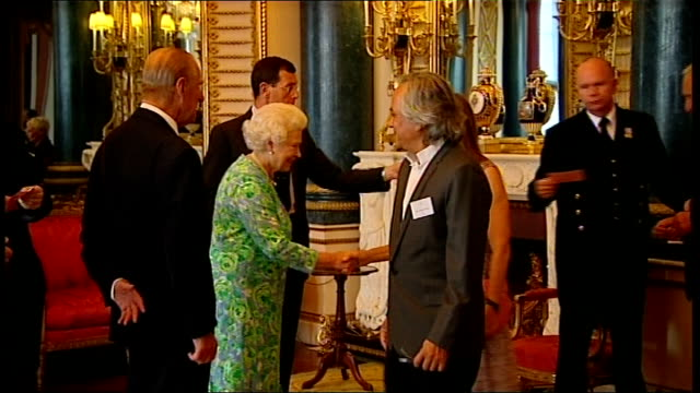 queen reception for praemium imperiale award winners; queen into room, doors opened and she receives guests at reception for recipients of the... - ジュディ・デンチ点の映像素材/bロール