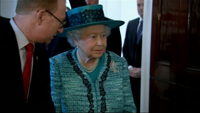 queen reopens canada house upsot cheers and applause as queen walks into room / cu queen / queen meeting more staff / view through window of... - canada house stock videos and b-roll footage
