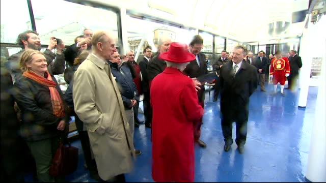 Queen reopens Cutty Sark to the public and launches Diamond Jubilee barge Queen being presented with gift / applause SOT / 3 cheers for the Queen and...
