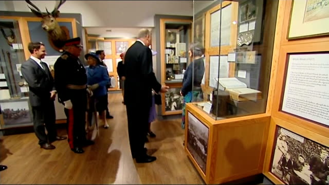 queen reopens former home of sir walter scott queen being shown photographs of her family visiting museum / queen being shown john buchan exhibition... - john buchan stock videos & royalty-free footage