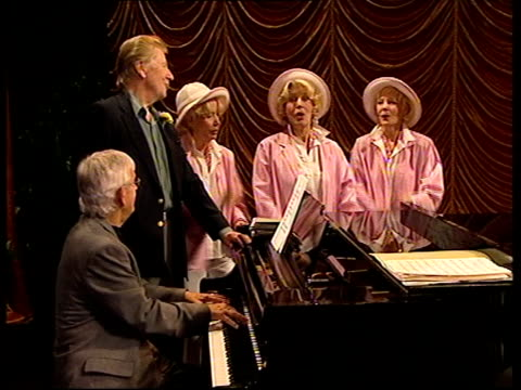 queen re-opens theatre; england: london: catford: broadway theatre: int max bygraves and the beverley sisters performing song and dance routine on... - max bygraves stock videos & royalty-free footage