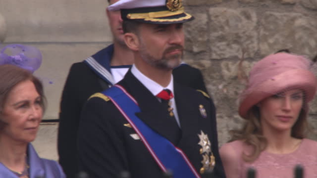 queen sofia, prince felipe, princess letizia of spain, princess victoria and prince daniel of sweden at the royal wedding departures westminster... - svezia video stock e b–roll