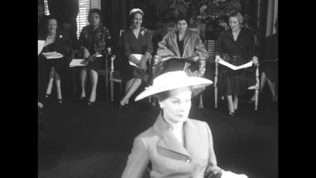 Queen Soraya of Iran wearing bandage on right ankle and entourage attend fashion show at Hamilton House in London / models all curtsy to Queen then...
