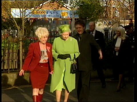 queen spends day with broadcasters bbc ext sign outside the queen victoria pub on the eastenders set tilt down queen and barbara windsor along pan... - イーストエンダーズ点の映像素材/bロール