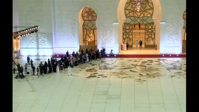 Queen state visit to Abu Dhabi UNITED ARAB EMIRATES Abu Dhabi Sheikh Zayed Mosque EXT / NIGHT ***FLASH Various GVs of exterior of mosque Dignitaries...