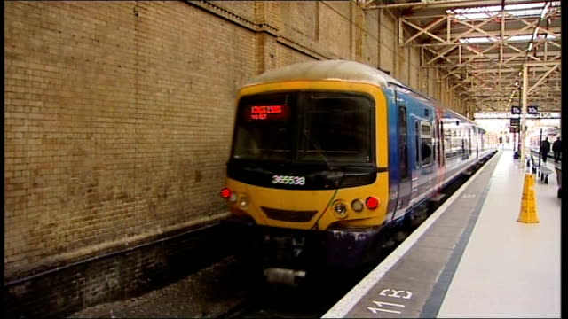 queen takes first capital connect train to sandringham; kings lynn train pulls out of station - イーストアングリア点の映像素材/bロール