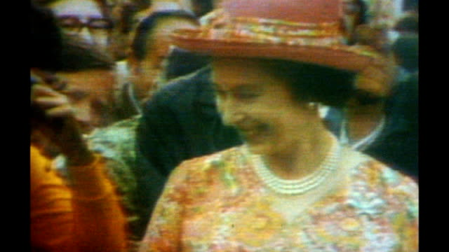 queen to miss commonwealth heads of government as scales down duties 1973 ottawa queen along to meet crowd in rain photography *** queen prince... - british empire stock videos & royalty-free footage