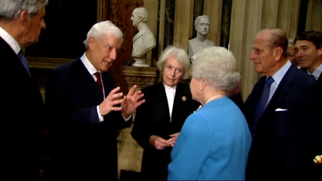 queen unveils bust of herself at house of lords england london house of lords int queen elizabeth and prince philip up stairway with others and... - brian rix stock videos & royalty-free footage