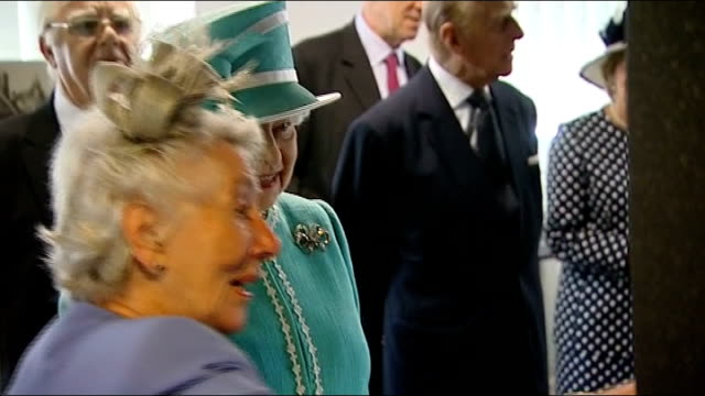Queen unveils memorial to Bletchley Park codebreakers Queen's museum tour Long shot of Queen and Prince Philip meeting military personnel Queen...