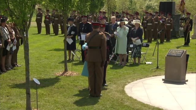 queen unveils memorial to the fallen at the national memorial arboretum all stand for 'the last post' sot / man plays trumpet sot / queen along with... - music stand stock videos and b-roll footage