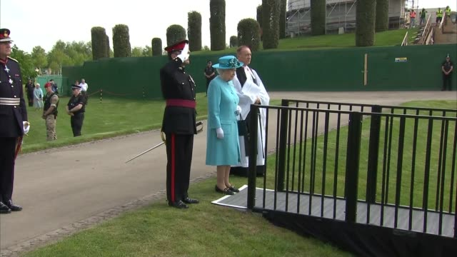 queen unveils memorial to the fallen at the national memorial arboretum queen and others stand for national anthem sot - music stand stock videos and b-roll footage