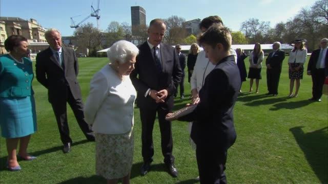 Queen unveils plaque for Commonwealth Walkway ENGLAND London Buckingham Palace EXT Queen Elizabeth II along in garden of Buckingham Palace and...