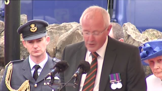 queen unveils wwi statue in bushmills village all stand for national anthem / sermon / queen unveils statue / queen chats with public - music stand stock videos & royalty-free footage