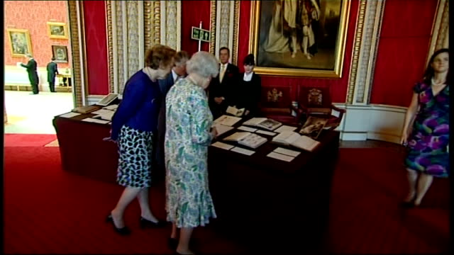 queen victoria's diary available on the internet; buckingham palace: queen elizabeth looking at display of exhibits relating to queen victoria diaries - diary stock videos & royalty-free footage