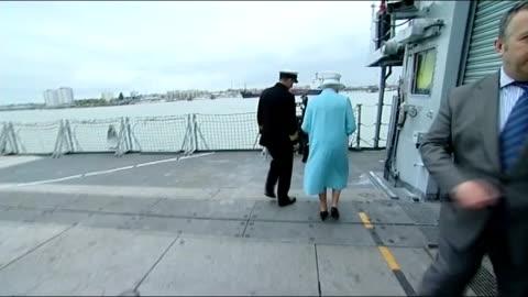 """vídeos y material grabado en eventos de stock de queen visit hms lancastesr, """"the queen's frigate""""; hms lancaster: ext queen piped aboard frigate, meeting royal marines and being escorted across deck - royal marines"""