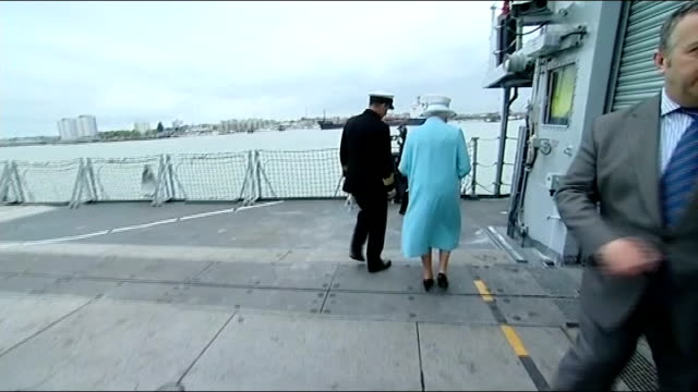 """queen visit hms lancastesr, """"the queen's frigate""""; hms lancaster: ext queen piped aboard frigate, meeting royal marines and being escorted across deck - royal marines stock videos & royalty-free footage"""