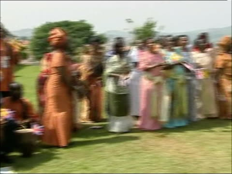 Queen visit to AIDS clinic in Kampala EXT Queen along on hospital tour / Drummers playing music as Ugandan women perform traditional dance SOT /...