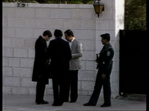 preparations jordan amman king hussein greets men on walkabout his bodyguard close by gv british embassy bldg ms guard outside british embassy ms... - overtaking stock videos and b-roll footage