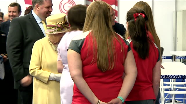 queen visit to kelvin hall, glasgow.; queen and duke of edinburgh talk to staff / queen and duke presented with gifts of tartan material and tie - tartan stock videos & royalty-free footage