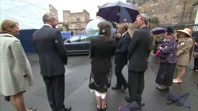 queen visit to lancaster castle crowds cheering / speeches / crowds / soldiers / queen presented with gift / queen along into waiting car / queen... - castle stock videos & royalty-free footage