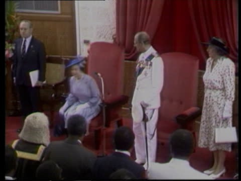 queen visit to mark 350th anniversary of parliament; barbados: ext members of military band in white dress uniforms march towards as music sof... - uniform stock videos & royalty-free footage