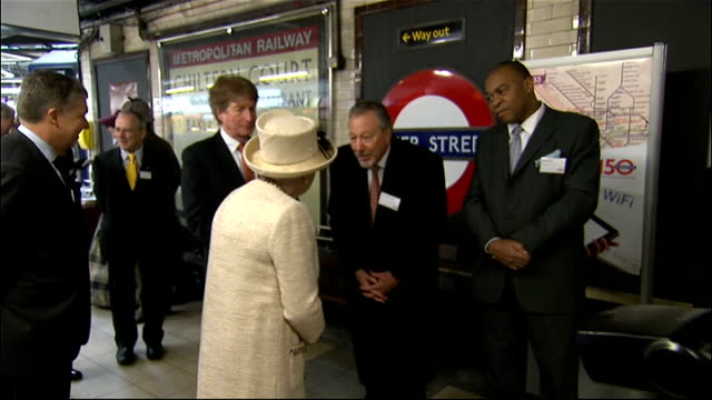 queen visits baker street station to mark 150th anniversary of the tube: royal visit; couple dressed in victorian dress on platform - man dressed as... - sherlock holmes stock videos & royalty-free footage