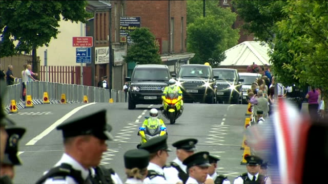 queen visits crumlin road gaol int baton held by prison officer pacing up and down inside prison / ext mcguinness and robinson waiting / school... - motorcade stock videos & royalty-free footage